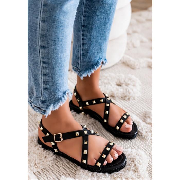 Melnas sandales ar metāla elementiem