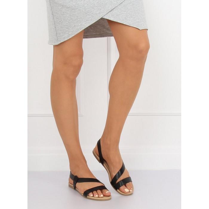 Sandales uz plakanas zoles