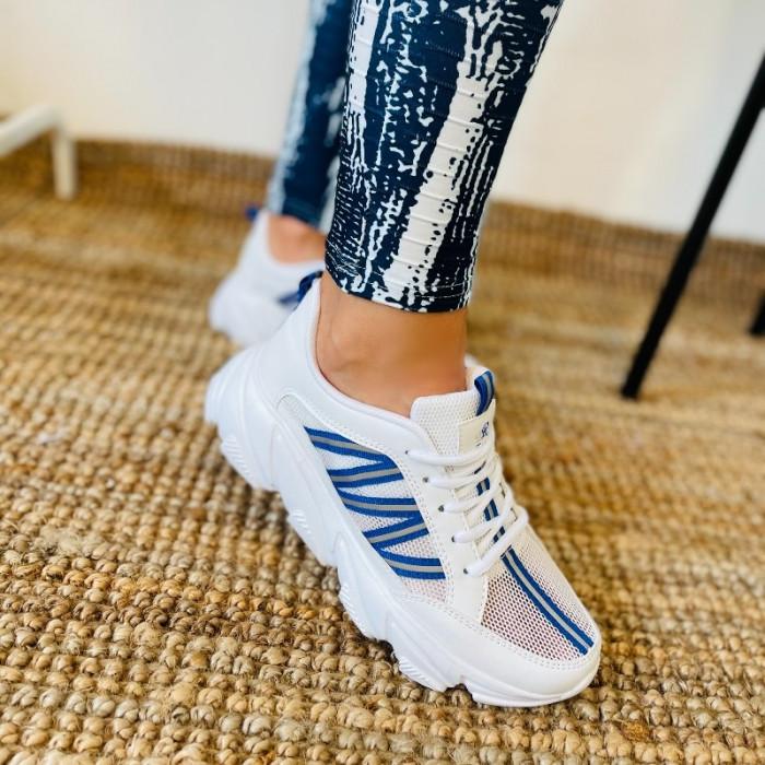 Balti sporta apavi ar ziliem akcentiem