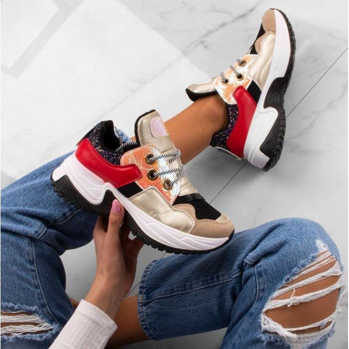 Zeltītas krāsas sporta apavi